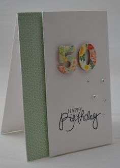 handmade birthday card ... luv the years die cut from floral paper and popped from the card surface ... clean and simple ...