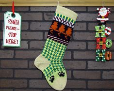 Hang this charming Christmas stocking by the fireplace this Christmas. I designed this stocking with the cat lover in mind. The cuff, heel and toe are an Off-White color called Heather. I also featured a Houndstooth pattern on the leg in Yellow and Green. The main attraction on this stocking are the Orange cats sitting watching for Santa to arrive. Fill with Christmas goodies and bring a custom touch to your Christmas decor!  FREE Personalization!! Your stocking can be personalized on the…