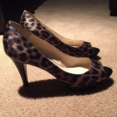 Leopard print heels-price firm @ this time Leopard print heels. Size 9. These shoes are in new condition without box. They have only been tried on inside my house. They are really pretty shoes that have been sitting in my closet. Never worn since I have a couple of other pairs similar that I tend to reach for and these are a bit small for me. No marks on exterior of shoe. Please note in last pic-small discoloration that I believe is dried up glue on interior arch area (was there when I…