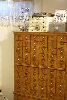I would love to have an old card catalog cabinet, but they are so freaking expensive!