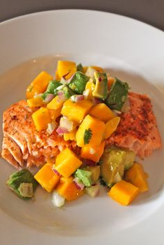 Salmon  Mango Salsa    For Mango Salsa:  1 mango, cubed  1 avocado, cubed, 1/4 cup red onion, diced, 2 tablespoons fresh cilantro, chopped,     2 tablespoons lime juice  1/2 tablespoon olive oil  1/2 teaspoon Sea Salt     Toss all of the ingredients together and serve over top of the Salmon.