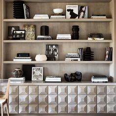 Black and white bookshelf styling. Love the millwork on this built-in.