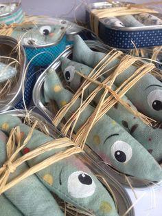 Textile painting, fabric scraps, sardines tinns