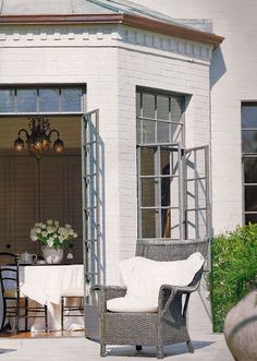 they added a sunroom with french doors and copper gutter to existing home, what a difference this charming addition makes to patio