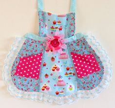 This sweet apron will have any girl smiling in no time! Whether she is playing in her kitchen, helping mommy prepare dinner, having a family BBQ, or just ready to have some fun! This apron has a halter style top and also ties around the waist. It is made with cotton fabric and is fully