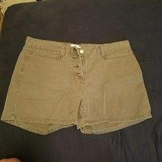 Button up shorts 100% cotton. No flaws. Wore a couple times. Looks like a faded green/gray Calvin Klein Shorts Jean Shorts