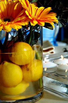 Tips for a beautiful home: You can jazz up your dinner table with a simple centrepiece using what you have handy! Just get a cylindrical jar and add fruits or flowers as you please! Tea candles make the perfect dinner atmosphere! Lemon Centerpieces, Summer Wedding Centerpieces, Wedding Decorations, Table Decorations, Graduation Decorations, Centerpiece Ideas, Wedding Tips, Our Wedding, Wedding Stuff