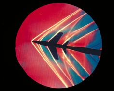 Schilieren photograph of an F11F-1 Tiger at Mach 1.4 in the 1-foot by 3-foot wind tunnel at NASA Ames. 1965.