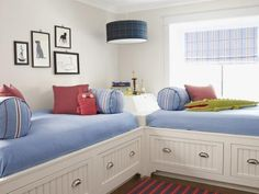 Do blue with: a drum shade. Joey's bedroom has a nautical feel, with its built-in twin storage beds connected by a latched storage unit for stashing books and trophies. Rosie went with a preppy vibe for her middle child, adding blue and red stripes—in the rug (melrosecarpet.com), window treatments, and bolster pillows—and a navy plaid drum shade.