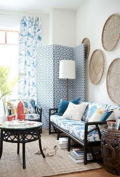 <3 artwork on walls (not so much all the blue, but I do like the cozy factor & the rattan furniture painted black).
