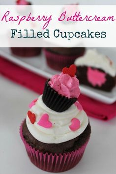 """Looking for the perfect Valentine's Day dessert recipe? Well, look no further. These Raspberry Buttercream Filled Cupcakes are AMAZING, and they're absolutely perfect for Valentine's Day, whether you're celebrating with your sweetie at home or baking treats for your kids' class parties at school. After all, they don't call it """"Devil's food"""" for nothing!"""