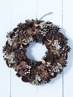 Natural wreath made from pine cones, twigs and dried flowers create a textural wreath.