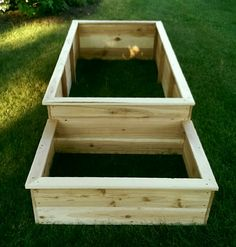 """Raised garden beds made from cedar fence post (dog eared) with 1"""" x 3"""" trim/moulding on top to give it a complete look. Small box in front for herbs or flowers."""