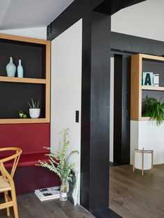 Black beams, white walls, red leather and wooden shelves in this contemporary interior - Valentine Bärg Architectures Built In Shelves, Wooden Shelves, Conservation, Lake Geneva, Contemporary Interior, White Walls, The Expanse, Interior Architecture, Beams