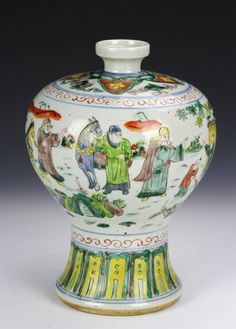 China, Ming period, Wucai vase, small opening, decorated with lively painted character scene and petal lappet on foot, student mark on base. Height 10 in., Length 7 in.