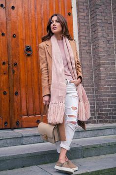 Negin Mirsalehi is wearing a camel midi coat in wool from ASOS, boyfriend Angie jeans from Mango, camel coloured slip-ons from Vince, pink scarf from Pocket and the bag is from Celine