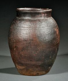 A Japanese Bizen Pottery Storage Jar ovoid body with incised banding around the shoulder, height 11 in