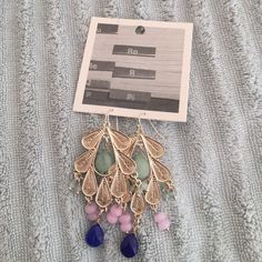 | New | Gorgeous anthropologie earrings Brand new anthropologie earrings, silver tone with a mix of mint, lilac and blue beads. Perfect everyday or for a special occasion, GREAT HOLIDAY GIFT! BUNDLE & SAVE 25% ❌TRADES ❌ Jewelry Earrings