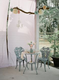 Very cute found objects and crafts for couple's table.