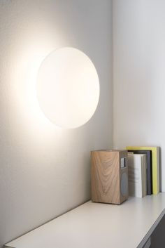 MAGA WALL Wall lamp with diffuser in opal blown glass and wall fixing painted in white. Available with LED kit.