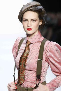 Lena Hoschek. [Still femme, but love the suspenders the masculine accessories.]