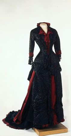 Empress Maria Fyodorovna's Evening Gown, by Fromont Firm, Paris, 1880s, at the State Hermitage Museum. Black satin embroidered with silk threads and glass beads.