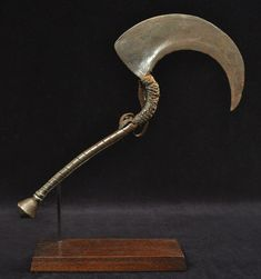 "Sickle blade, Nigeria   Ceremonial blade Verre, Nigeria Hand forged iron, leather 14.5"" (37 cm) long Early 20th century"