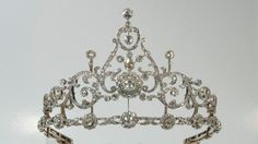 c1895 Gold, silver, and rose cut diamonds by Dutch jeweler BC Reeser & Sons. 'It is performed in the neo-Louis XVI style, with addtl frames to convert the tiara to a necklace, brooches and hair ornaments.'