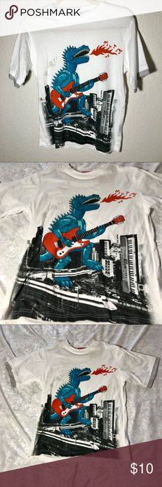 "Unionbay Boys T-Shirt Dinosaur playing Guitar Pre Owned  In great condition  No tags  It's about 23 1/2 Long Chest 17 1/2 Sleeves 8""  😊😊😊 UNIONBAY Shirts & Tops Tees - Short Sleeve"