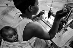 Former child abductee practices with her baby sewing at World Vision Children of War Rehabilitation Center, Gulu, northern Uganda, Dec. 2005. Since the Lord's Resistance Army (LRA) waged war against the Ugandan government more than two decades ago, northern Uganda had witnessed more than 30,000 children abducted. Their parents murdered and homes burnt down, children were kidnapped at night, taken to the LRA training camps (the Bush), forced to fight as soldiers or serve as sex slaves…