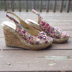 """Madden girl floral print bow cork like wedges A must have for the summers. Floral wedges with cute bow detail at the toe. Cork like platform design with espadrille trim in between. Fits true to size. 4"""" inch heels height. 1.5"""" platform. Very comfortable. Thank you for looking. Madden Girl Shoes Wedges"""