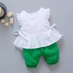 New Style 2017 Summer Baby Girls Clothes Sets Lace T Shirt Shorts 2 Pcs Infant Suits Comfortable Cotton Kids Casual SuitsGeorgia- Solid color two piece set. White sleeveless ruffle top with bow tie sides and layered lace ruffle bottom. Kids Frocks Design, Baby Frocks Designs, Baby Girl Dress Patterns, Baby Dress Design, Frocks For Girls, Toddler Girl Dresses, Kids Dress Wear, Girls Wear, Baby Suit