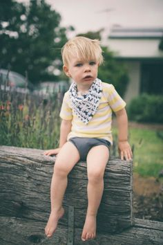 Baby Harry wearing Fable Baby organic cotton Placket Tee in Yellow Stripe (AUD$45), Bandana Bib in Navy and White Animals (AUD$19) and Charcoal Nappy Pants (AUD$29)