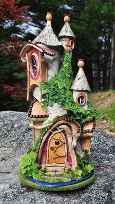 Dragon Faerie House, so named because of the piece of driftwood that arches over the doorway… by Sally J Smith ... fairy