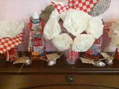 Kitchen shower- dish soap bottle with apron, kisses chocolate with thank poem, coca cola cans with coffee filter as a flower, coca cola cup with flower made from cupcake liners and bendable straws as the flower stems