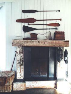 Mankas Inverness Lodge Boat House Mantel | Remodelista. #boatoars #fireplace #fisherman
