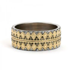 Beautiful bangle with matte gold-tone diamonds in two tight rows, surrounded by cool embedded grey crystals