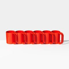 Heller Red Mugs Set Of 6   Unison   Your morning coffee needs technicolor pop. Re-created from a vintage, iconic Massimo Vignelli design, these lightweight mugs are also great for kids. Plus, they're stackable and can be used for both hot and cold beverages. Dishwasher and microwave safe.