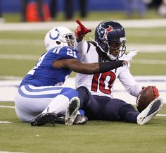 Dec 20, 2015; Indianapolis, IN, USA; Houston Texans wide receiver DeAndre Hopkins (10) signals that he made a first down against Indianapolis Colts cornerback Vontae Davis (21) at Lucas Oil Stadium. The Texans won 16-10. Mandatory Credit: Brian Spurlock-USA TODAY Sports (2670×2456)