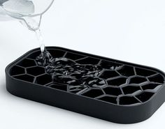 Voronoi silicone ice tray features quick release of classic ice cubes individually or all at once.