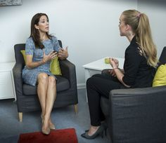 Crown Princess Mary engaged in conversation with TUBA's youth ambassador.