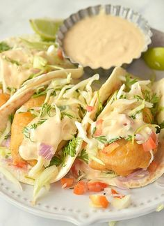 The Ultimate Crispy Baja Fish Taco Recipe Try these amazing Baja Fish Tacos served in a cozy warm tortilla with pickled cabbage slaw,pico de gallo and flavorful chipotle crema Baha Fish Tacos, Baja Fish Tacos Sauce, Mexican Fish Tacos, Baja Fish Taco Recipe, Slaw For Fish Tacos, Baja Sauce, Fish Tacos With Cabbage, Fried Fish Tacos, Taco Cabbage Slaw