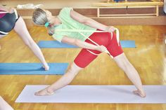 Utthita Trikonasana - straps to teach shoulder blades to go down the back while staying broad across the chest