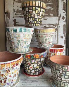 Few mosaic projects are more satisfying and practical than decorating a basic terra cotta flower pot. I've probably lost track of how ma. Mosaic Flower Pots, Terracotta Flower Pots, Butterfly Mosaic, Mosaic Planters, Mosaic Vase, Mosaic Tables, Garden Planters, Mosaic Projects, Diy Garden Projects