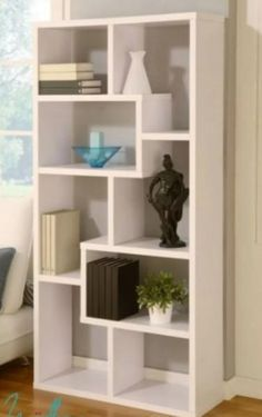 Found it at AllModern - Masima Unique Bookcase / Display Cabinet in White. This asymmetrical white bookcase is the perfect addition to your modern living room. You can store your books, frames, small pieces of art and enjoy looking at them everyday. Home Office Furniture, Furniture Decor, White Furniture, Books Decor, Regal Display, Floating Shelves Bathroom, Bookshelf Design, Office Bookshelves, Bookcases
