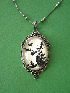 Peter Pan Necklace pendant on chain by tinatarnoff on Etsy, $50.00