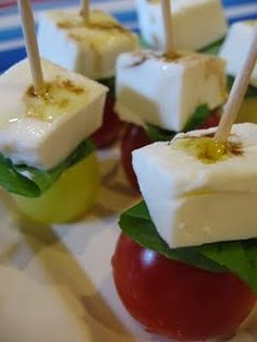 Caprese Appetizers... tomato, basil, mozzarella drizzled with olive oil and balsalmic. good for a shower.