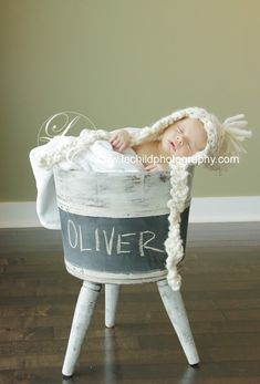 large bucket (or vintage crate) with chalkboard paint for baby's name...and something soft & cozy inside. I think I could make this.