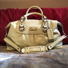 COACH Ashley Handbag 100% authentic Coach Ashley leather satchel handbag that can be converted into a tote. Features soft and supple calfskin leather soft green with shiny silver hardware, Coach logo nameplate, double rolled handles, Coach leather decorative hangtag, zip top closure, and a leather detachable strap for carrying versatility. The Coach Ashley has a single compartment lined in complementary shimmery champagne-silver sateen. Inside is one zipped wall pocket and one accessory…