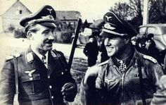 German fighter aces Adolf Galland and Joachim Müncheberg. Southwest of St. Omer. France, 1941.